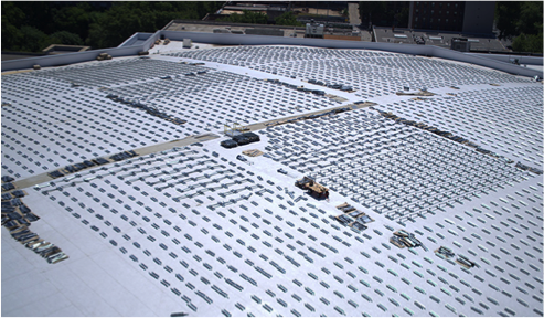 racking for a rooftop solar array on a stadium gets installed in preparation for the panels