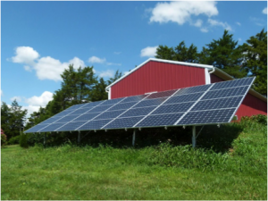 this ground-based solar array powers the barn it's attached to