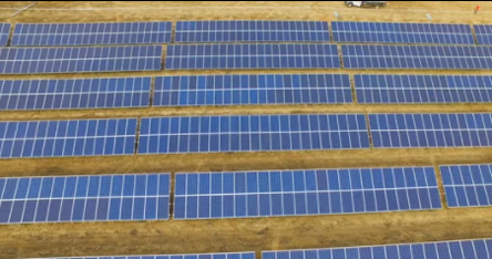 screenshot of video about poultry farm solar power project