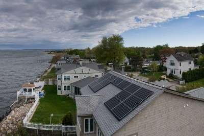 This home probably has higher resale value because of these solar panels, but by how much, and what are the variables?