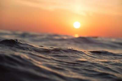 photo of the sun over the water