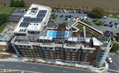 hotel with solar panels on the roof
